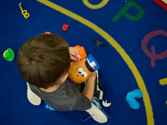 A student plays with a Mr. Potato Head in a Early Childhood Special Education classroom Thursday, November 5, 2015 at Kimball Elementary School.
