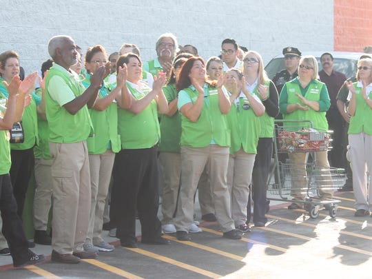 Wal-Mart Neighborhood Market employees applauded after several Alamogordo nonprofits received grant funds from the store Wednesday morning.
