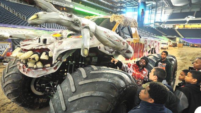 Monster Trucks And Dinosaurs Invade Detroit
