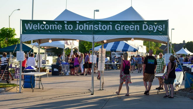 People walk towards the entrance Friday, June 17, 2016, during Green Days carnival at Johnston Public Library.