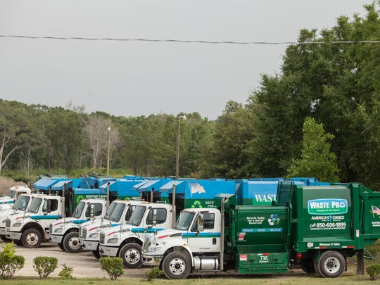 Trucks are parked at a Waste Pro USA Inc. facility in Midway on Wednesday.