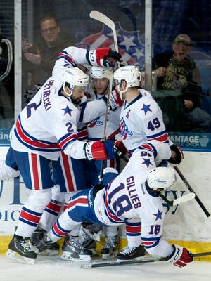 The Rochester Americans celebrate a goal by Chad Ruhwedel.