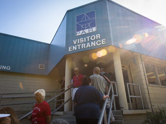 Visitors to the Pisgah Astronomical Research Institute in Rosman enter the visitor's center for speakers and other programming Tuesday, August 21, 2017.