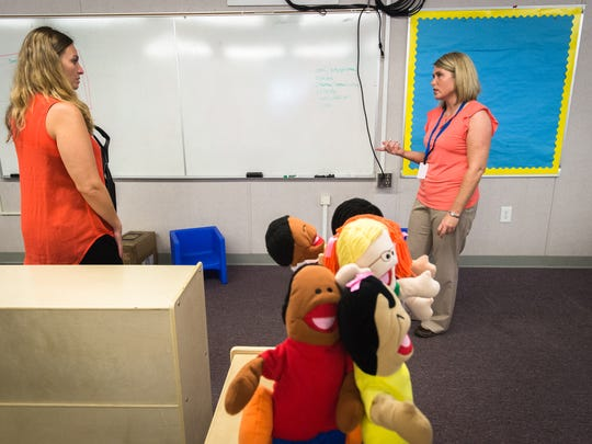 Lana Fedun, a teacher assistant at Johnston Elementary School, and Angie Sercy, one of the teachers, set up a new preschool classroom Aug. 23.