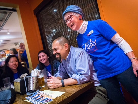 City council candidate Vijay Kapoor and his campaign manager, Pat Deck, share a moment at their election party at Rocky's Hot Chicken Shack after the general election Tuesday, November 7, 2017.