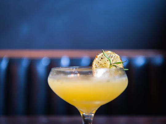 A cocktail served at Polanco Mexican restaurant in Asheville made with tequila, peach nectar, smoked rosemary, and caramelized lemons.