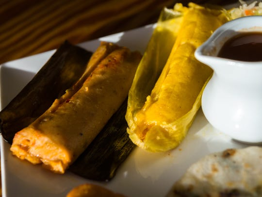 A pork tamale and a chicken tamale, two items featured