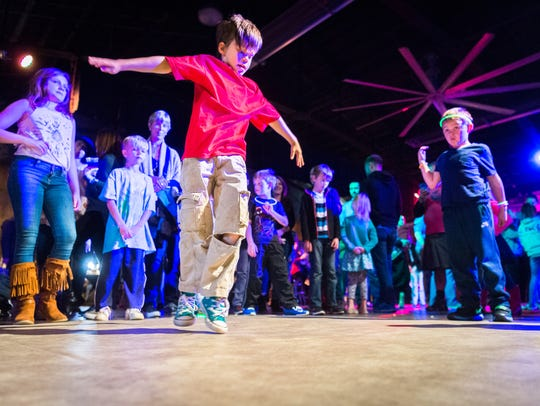 Miles Boissy, 8, of Asheville, dances at the Kid hop