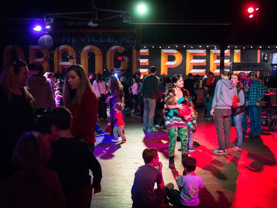 "People dance at the Kid hop Hooray wintertime indoor dance party at the Orange Peel, Saturday, November 25, 2017. The event was hosted by The Hop Ice Cream Cafe which hosts dance parties every Wednesday night with local BBoy dancer Joseph ""Joe America"" Adams."