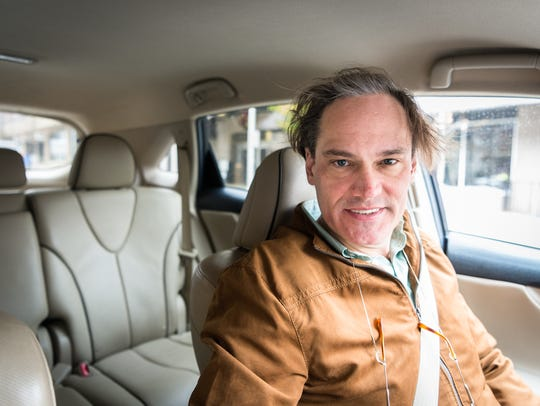 Woody McKee, owner of Asheville Taxi Company, in his