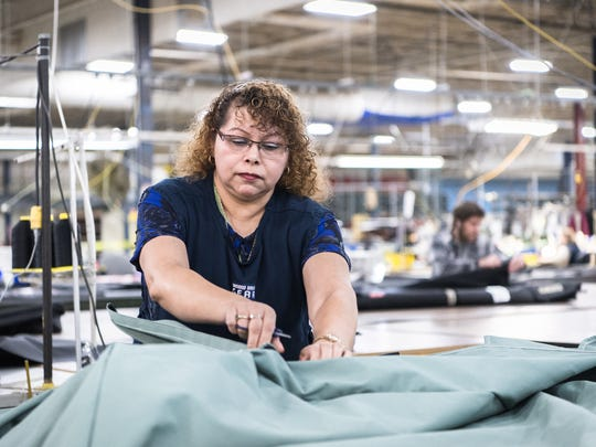 Rosa Trejo, an inspector at Diamond Brand Gear in Fletcher, works on the floor at their warehouse Thursday, January 11, 2018. Trejo who has been living in the United States since 1997, is one of hundreds of thousands of Salvadorans living in the country under the program, Temporary Protected Status who have been ordered to leave the country after government officials announced on Monday that they were ending the program.