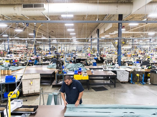 Workers sew tents for the military and other outdoor gear in Diamond Brand Gear's 60,000-square-foot factory in Fletcher. The company is transitioning part of its workforce to making personal protective gear, including medical gowns, to help meet local demand in fighting the coronavirus pandemic.