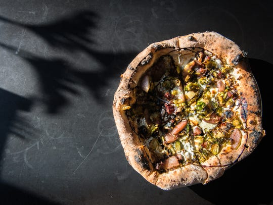 White Labs Kitchen and Tap's Brussels pizza topped