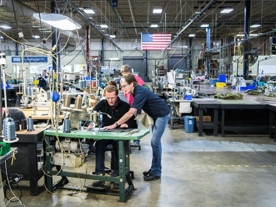 Diamond Brand Gear employees assist members of the