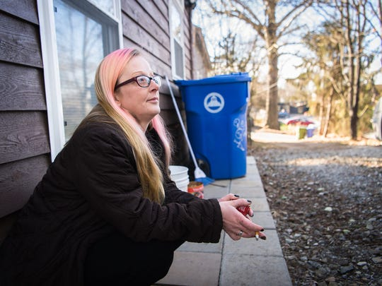 Hope Bishop smokes a cigarette outside her apartment in Asheville before her drug court graduation ceremony at the Buncombe County Courthouse, Friday, February 2, 2018.