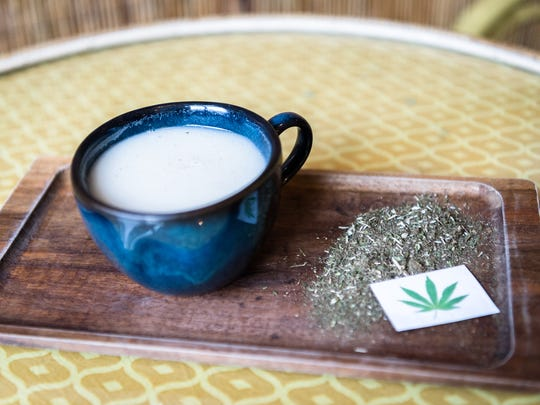 A cup of Dobra Tea's CBD hemp latte made with ground cannabis flower leaves simmered in coconut or cow milk with local honey.