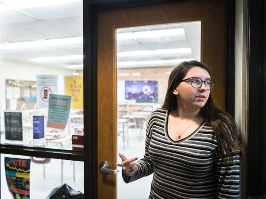 Caitlyn Carter, a senior at Swain High School, stands in front of one of many classrooms that are surrounded by thin, glass windows. She is one of the students who helped organize a walkout Friday, February 23 in solidarity with survivors of the shooting in Parkland, Florida the day after a lockdown took place at her school.