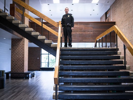 Anthony Renfro, the school resource officer assigned to Mountain Heritage High School for the last 19 years, stands near the student entrance of the school - one of 37 entry points.