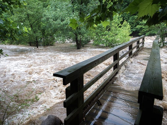 A flooded Rocky Broad River in Chimney Rock, washes