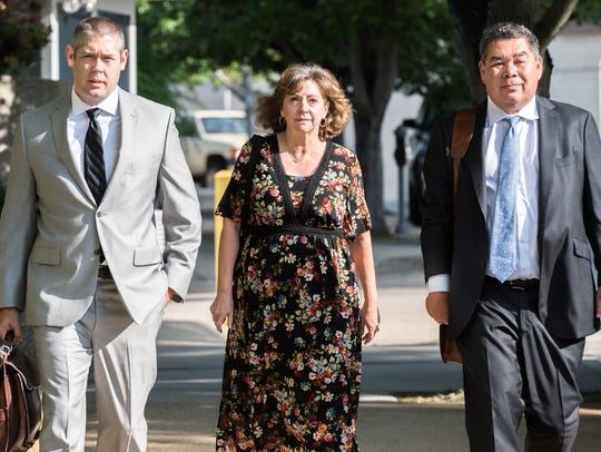 Wanda Greene, former Buncombe County Manager, walks
