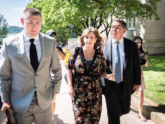 Wanda Greene, former Buncombe County Manager, walks from the federal courthouse with her attorney Thomas Amburgey and Noell Tin, Wednesday, June 13, 2018, after appearing before a U.S magistrate judge where she was indicted on additional charges of using public money to buy life insurance policies for herself and other employees, entering a plea of not guilty. Greene was indicted in April on charges of wire fraud, conspiracy, embezzlement and aiding and abetting.