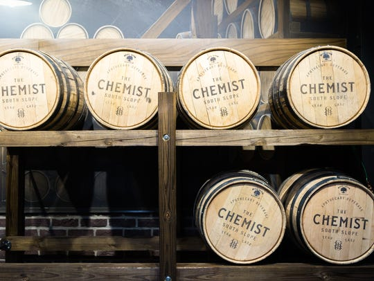 Racks of barrels at The Chemist on Coxe Avenue in Asheville's