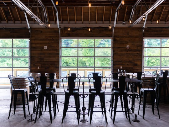 The interior of plēb urban winery in Asheville's River