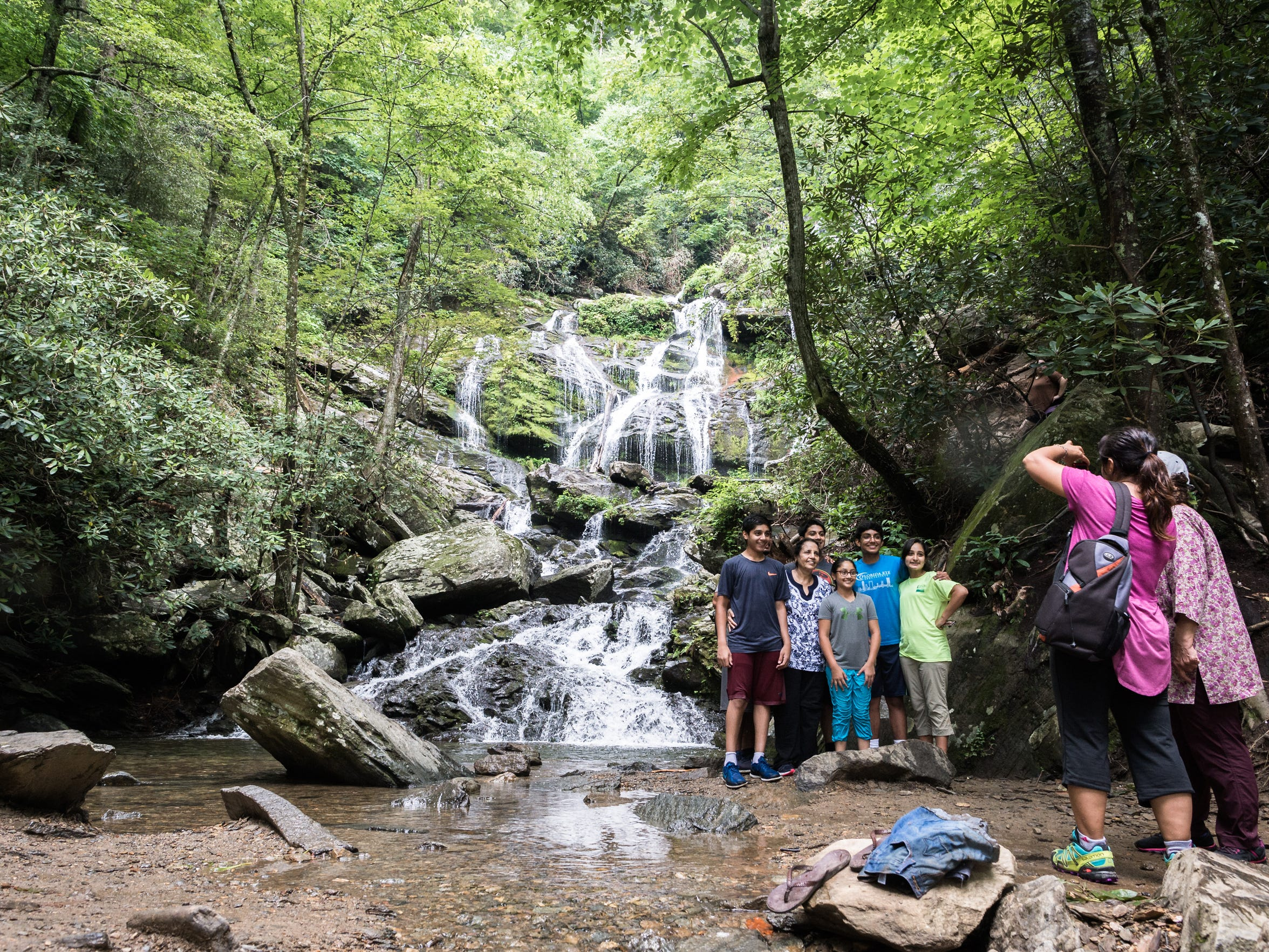 A family poses for a portrait at the base of Catabwa Falls in the Pisgah National Forest in Old Fort, Friday, July 13.
