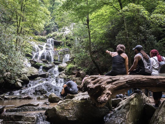 Visitors to Catabwa Falls in the Pisgah National Forest