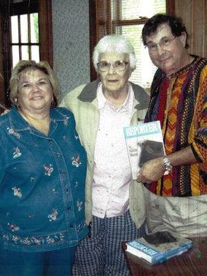 Al and Sharon Benn were joined by Harper Lee, center,  at the Monroeville Public Library in 2006.  Al autographed two copies of his autobiography for the Pulitzer Prize winning author.