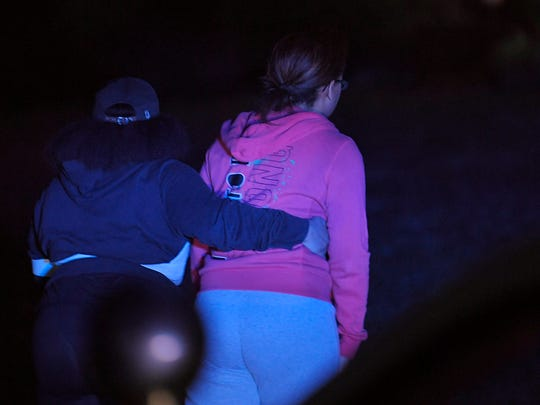 People walk by near the scene where Franklin police