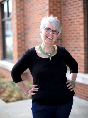 Professional storyteller Connie Regan-Blake stands at the Asheville Chamber of Commerce building earlier this month. Regan-Blake led an all-day workshop on storytelling at the Lenoir-Rhyne graduate school at the chamber.