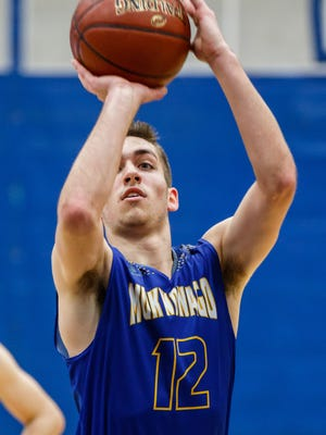 Mukwonago senior Connor Tess (12) shoots from the line during the game at Waukesha West on Friday, Jan. 12, 2018.