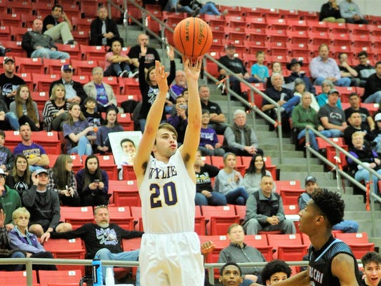 Wylie guard Sam King (20) takes a 3-point shot during