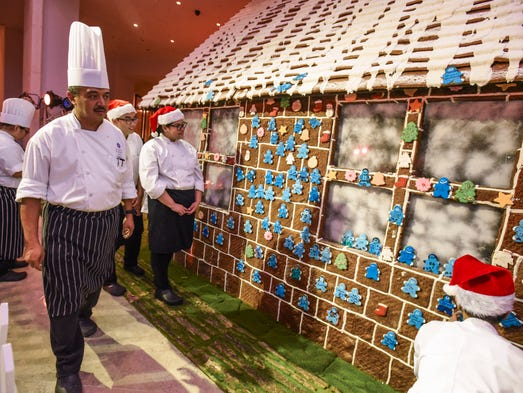 Chef Suharto checks over his full-sized gingerbread
