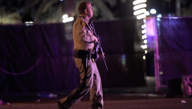 Las Vegas police patrol along the streets outside the the Route 91 Harvest country music festival grounds after a active shooter was reported on October 1, 2017 in Las Vegas, Nevada. A gunman has opened fire on a music festival in Las Vegas, leaving at least 2 people dead. Police have confirmed that one suspect has been shot. The investigation is ongoing.