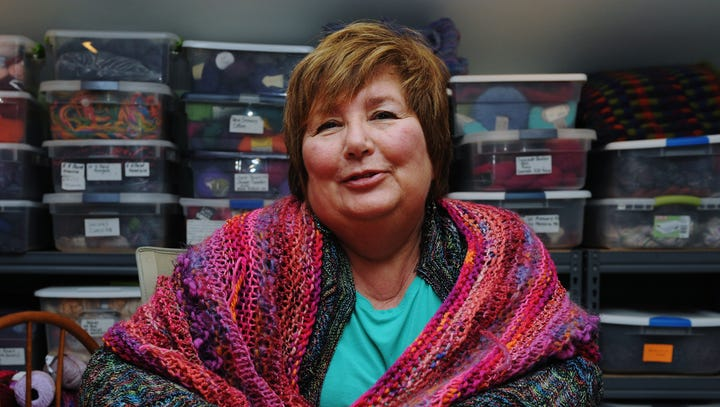 Knitter rips out old stitches for new projects
