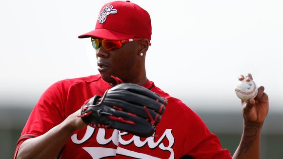 Reds pitcher Aroldis Chapman warms up during practice at spring training in Goodyear.