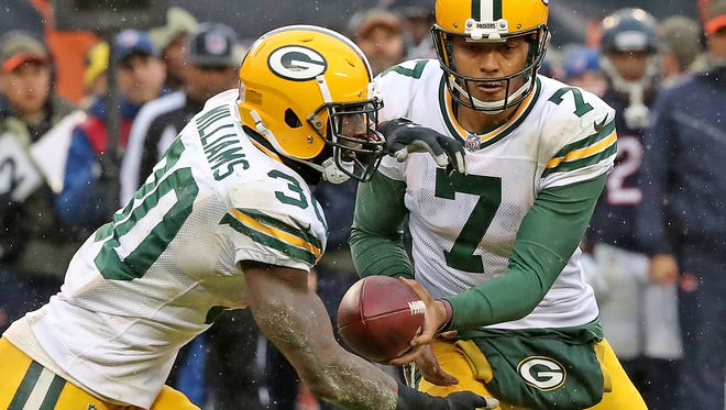 Green Bay Packers quarterback Brett Hundley (7) hands off to running back Jamaal Williams (30) against the Chicago Bears Sunday, Nov. 12, 2017 at Soldier Field.