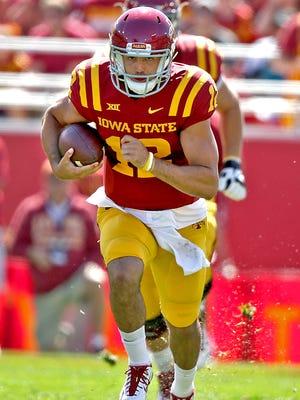 Iowa State quarterback #12 Sam Richardson broke off a long run against Kansas State during football game at Jack Trice Stadium in Ames on Saturday Sept. 6, 2014.