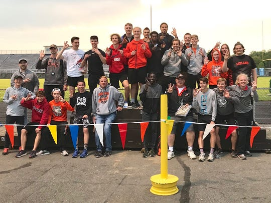 The Ashland boys celebrate their third straight Ohio Cardinal Conference title.