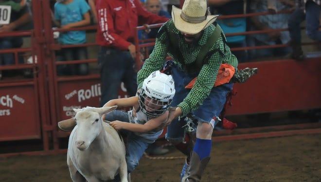 Hayden Dillon, 4, Searsboro, participates in Mutton Bustin' at the Iowa State Fair on Aug. 18.