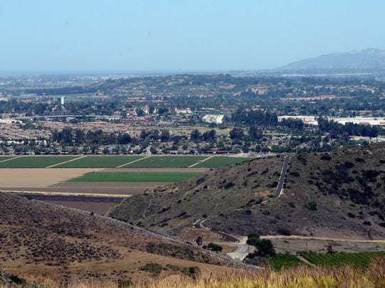 A panoramic view seen from the Conejo Grade shows agricultural