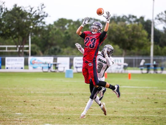 Palmetto Ridge's Calvin Celestin covers Estero's Jose Garcia as he goes up for the pass. Garcia couldn't hold on to it. Palmetto Ridge played at Estero Tuesday night.