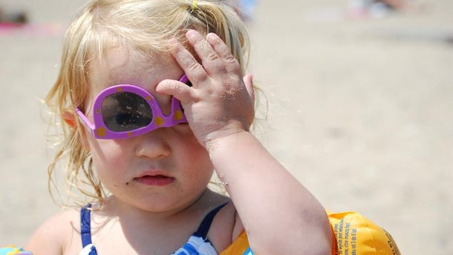 Grace Davis adjusts her sunglasses at Lighthouse Beach in Port Huron.
