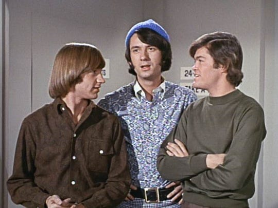 Monkees Peter Tork (from left), Mike Nesmith and Micky Dolenz.