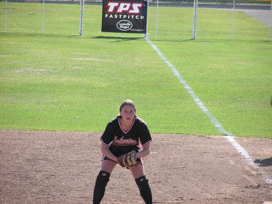 Former Farmington softball player Falynn Burns plays first base for Northwestern Oklahoma State University in May 2004 during a game in Dallas, Texas.