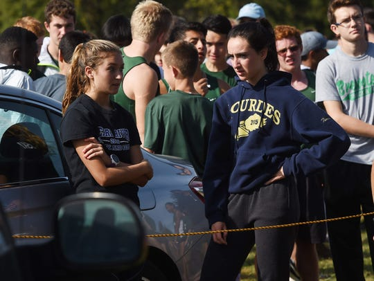 Lourdes' Caroline Timm, right, waits for her race during