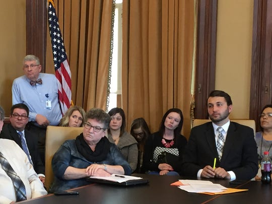 Reps. Mary Mascher, left, and Bobby Kaufmann listen to testimony Monday about House Study Bill 138.