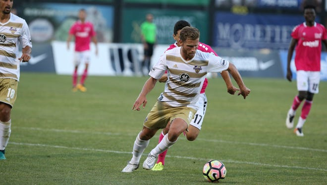 A Louisville City FC player goes after the ball in Saturday's game against Harrisburg City. June 24, 2017